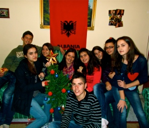 Me with my Model U.N. students. We had a party before our first competition and they came over to decorate my Christmas tree!
